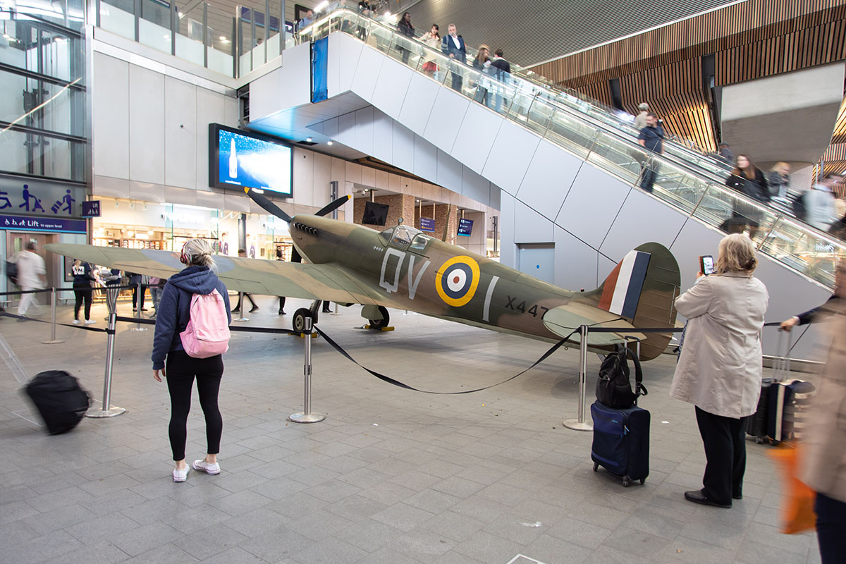 Commuters admiring the Veterans Day 75th Anniversary Spitfire at London Bridge Train Station.
